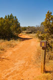 Desert walking trail and distance marker sign post Stock Photography