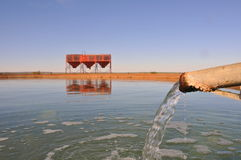 Desert water reservoir. An open water reservoir or holding pond for agricultural use in the desert Stock Photos