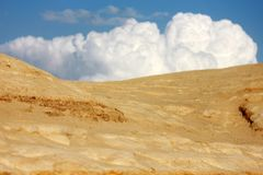 Desert and white clouds Royalty Free Stock Images