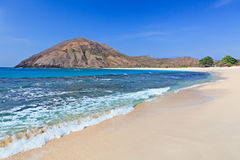 Desert white sand beach on ocean bay Mawun in Lombok. Tranquil scene on best desert beach with white sand, clear water on ocean bay Mawun in tropical island Royalty Free Stock Images