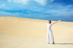 Desert woman. Beautiful woman with opened nahds in desert Royalty Free Stock Photography