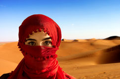 Desert. Woman with red scarf in the Desert Royalty Free Stock Images