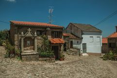 Deserted alley and old small house with stone walls. Deserted alley and charming old small house with stone niche for saints, in a sunny day at Belmonte. A cute stock image