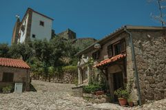 Deserted alley and old small house with stone walls. Deserted alley and charming old small house with stone walls, in a sunny day near the medieval Belmonte stock image
