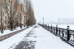 The deserted avenue in winter. Desert alley on the shore of ishim in winter Astana Royalty Free Stock Photo