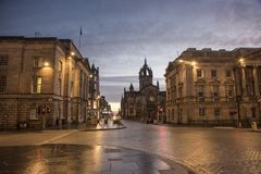 Early morning on Bank Street, Edinburgh. Deserted Bank Street in Edinburgh in the early hours of the morning, just before sunrise royalty free stock images