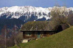 Deserted barn. On mountain background Stock Image