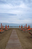 Deserted beach. A deserted beach in a cold day in summer Stock Image