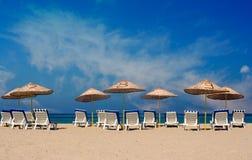Deserted beach. Sun loungers on a deserted beach Stock Images