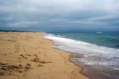 Deserted Beach. On cloudy day stock image