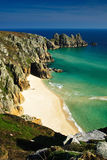 Deserted beach. Image showing empty beach at Pednvounder near Porthcurno in West Cornwall, UK. Calm conditions on beautiful Spring day showing white sands Royalty Free Stock Photos