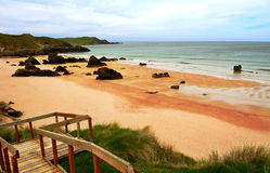 Deserted beach. A golden, deserted beach in Durness, with a gangway stock images
