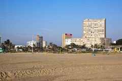Deserted Beach Against City Skyline in Durban Royalty Free Stock Images