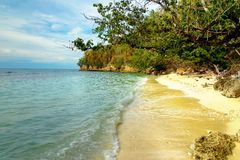 Deserted beach on Bolilanga Island. Deserted beach tropical beach on Bolilanga Island. Togean Islands or Togian Islands in the Gulf of Tomini. Central Sulawesi royalty free stock photo