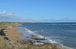 A deserted beach at Elie, Fife, on a sunny day. LA deserted beach at Elie, in the East Neuk of Fife, looking along the coast to St Momans and Pittenweem Royalty Free Stock Images