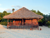 Deserted beach hut, evening, Varadero, Cuba. Deserted wooden and palm beach hut in evening light, Varadero, Cuba royalty free stock photos
