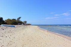 Deserted beach in Indonesia. Deserted beach and crystal clear water in Indonesia Royalty Free Stock Images