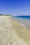 The clear Ionian sea washing gently over an empty Kefalonian beach Royalty Free Stock Photos
