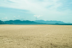 Deserted beach with mountains on horizon. In Vietnam Stock Photos