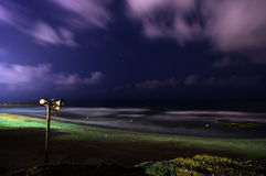 Deserted beach at night with Siren. Dramatic scene of a deserted beach at night with Siren Royalty Free Stock Photography