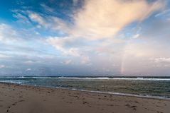 Cape Cod in November. Deserted beach with rainbow over the ocean, Cape Cod, Massachusetts stock image