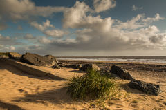 Deserted beach. Beach with rocks and marram grass a Huttoft Bank,Lincolnshire Royalty Free Stock Photography
