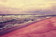 Deserted beach in stormy weather Stock Image