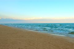 Deserted Beach at Sunrise. In Summertime - Lake Michigan, USA deserted beach in the early morning at sunrise stock image