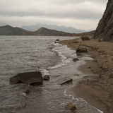 Deserted Beach in winter. Crimea, Ukraine Royalty Free Stock Photography