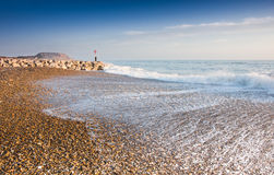 Deserted beach in winter. Hengistbury Head Bournemouth on a fine winters day showing pebbles and groynes Royalty Free Stock Photo