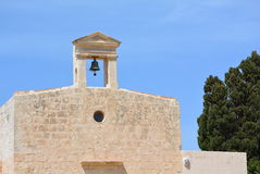 Deserted belfry. Deserted bell tower in the middle of nowhere - Malta Royalty Free Stock Image