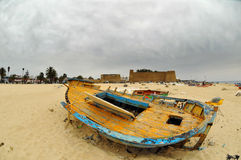 Deserted boat on a beach stock photo