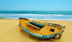 Deserted boat on a beach Stock Images