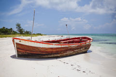 Deserted boat. On a beautiful beach Royalty Free Stock Image