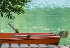 Deserted boat on lake. Deserted boat on a lake in summer afternoon in the flooded sand quarry Piskovna in Adrespassko-Teplicke skaly, Czech republic royalty free stock photo