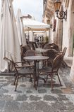 Deserted cafe on a rainy day. Rainy morning in the city. Empty street cafe. Romantic walk through the ancient city of Lviv, Ukraine Royalty Free Stock Images