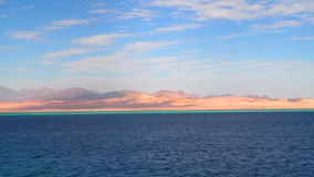 The deserted coastline of Sinai Egypt. View from the ship. Different color of water in the sea stock footage