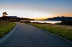 Deserted Curving Path at Dusk. Deserted Path through a Coastal Park at Dusk. Campbell River, BC, Canada Stock Images