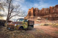 Deserted Dodge pickup vehicle parked near Twin Rocks trading post in Bluff, Utah Stock Images