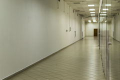 Deserted Empty Corridor with Glass and White Paint Royalty Free Stock Photo