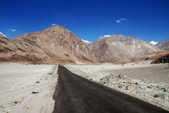 Deserted empty road with mountains Royalty Free Stock Images