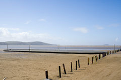Deserted English Beach. Weston Super Mare beach in England with fence posts stock images