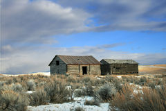 Deserted Farm House. A deserted farm house in a field in Montana on a sunny, winter\'s day Royalty Free Stock Image