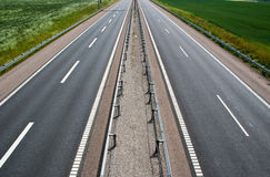 Deserted freeway. A empty stretch of a brand new two lane highway Royalty Free Stock Photo