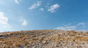 Deserted hill and blue cloudy sky in Summer Stock Images