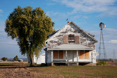 Deserted house. Deserted weathered house and windmill just off Route 67, outside of St. Louis Mo. Near bridge to Alton, IL Stock Images