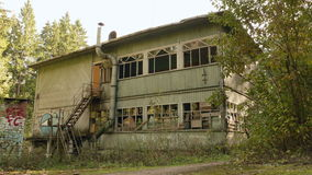 Deserted house in the forest. Autumn daytime. Smooth dolly shot.  stock footage