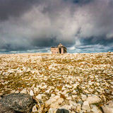 Deserted hunter's cabin in the high Arctic. A weather beaten hunter's cabin in the Arctic sits under a stormy sky royalty free stock photo