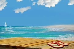 Deserted Island. Flipflops on dock by island surf with sailboat in distance Stock Photography