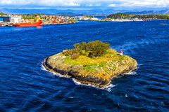 Deserted island with a lighthouse in the North Sea Stock Photos